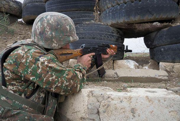 PHOTO: An Ethnic Armenian soldier holds a machine gun as he looks toward Azerbaijan's positions from a dugout on the front line, during a military conflict against Azerbaijan's armed forces in the separatist region of Nagorno-Karabakh, Oct. 21, 2020. (AP)