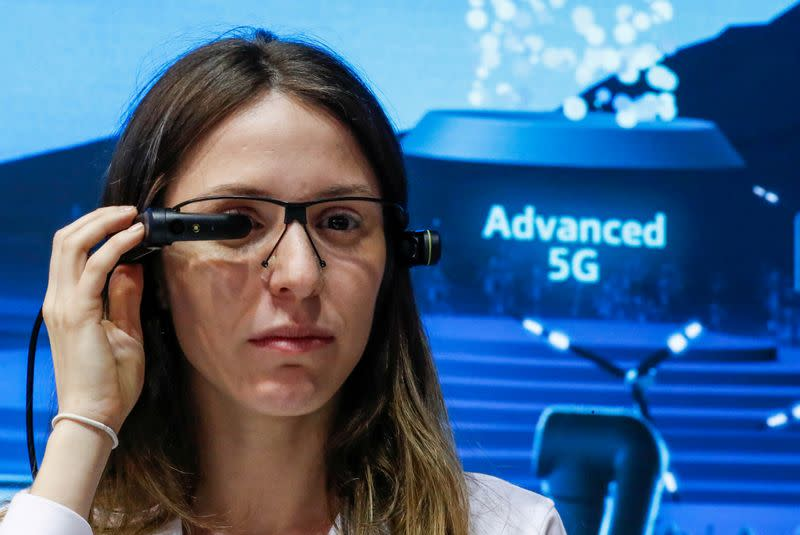 FILE PHOTO: A visitor tries out a VR headset at the Telefonica booth during the Mobile World Congress in Barcelona