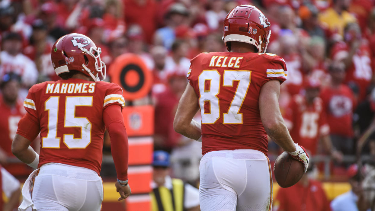 Kansas City Chiefs quarterback Patrick Mahomes and Kansas City Chiefs tight end Travis Kelce head off the field after connecting for a touchdown during the second half of an NFL football game against the Cleveland Browns, Sunday, Sept.12, 2021 in Kansas City, Mo. (AP Photo/Reed Hoffmann)