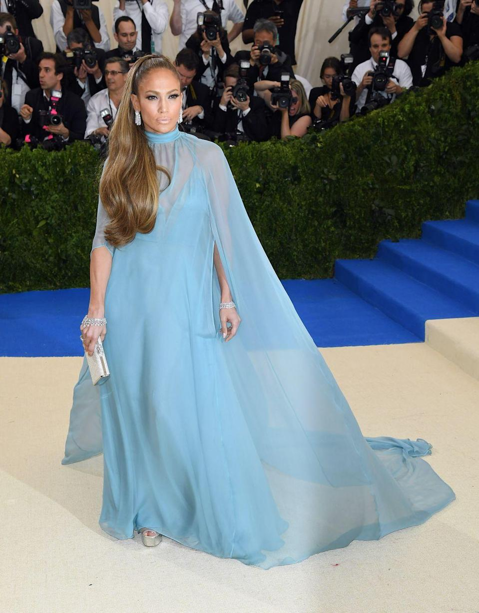 <p>Jennifer looks like a modern Cinderella in a flowy, blue Valentino gown at the 2017 Met Gala. That gorgeous sheer cape is the stuff of dreams. </p>