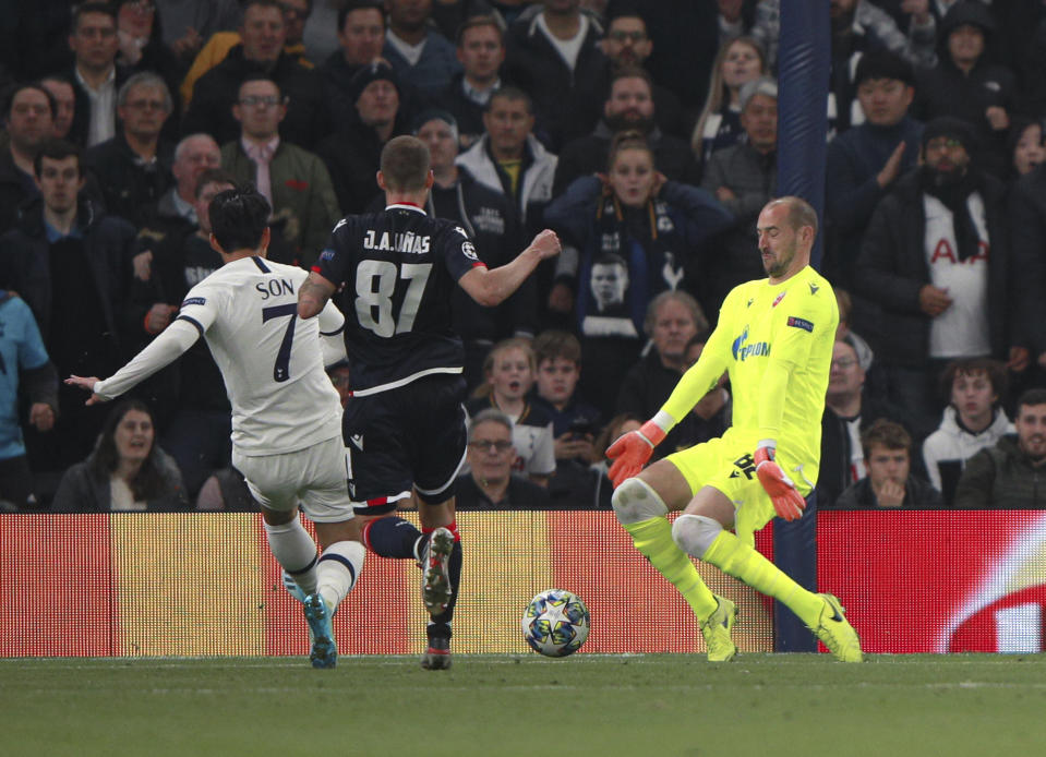 Tottenham's Son Heung-min, left, scores his side's third goal during the Champions League, group B, soccer match between Tottenham and Red Star Belgrade, at the Tottenham Hotspur stadium in London, Tuesday, Oct. 22, 2019. (AP Photo/Ian Walton)