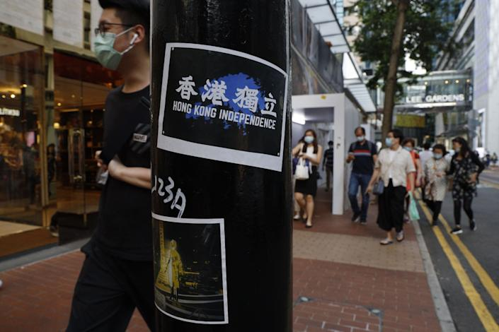 """Stickers with messages of the pro-democracy movement are posted in Hong Kong. <span class=""""copyright"""">(Kin Cheung / Associated Press)</span>"""