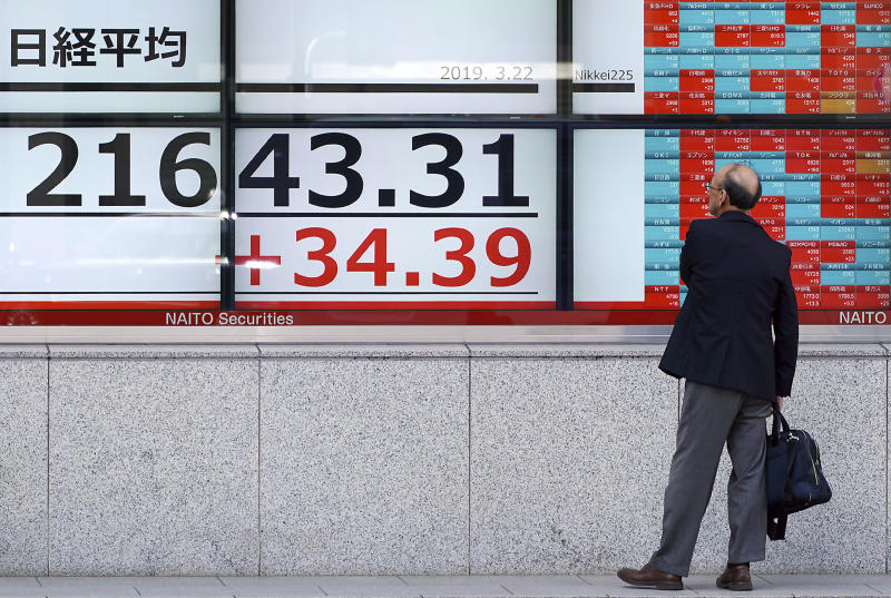 A man looks at an electronic stock board showing Japan's Nikkei 225 index at a securities firm in Tokyo Friday, March 22, 2019. Asian markets were mostly lower on Friday as investors mulled over the possibility of a trade deal between the U.S. and China in the near future, ahead of the continuation of talks in Beijing next week. (AP Photo/Eugene Hoshiko)
