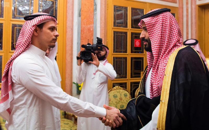Saudi Crown Prince Mohammed bin Salman (right) shakes hands with Salah Khashoggi, son of Jamal Khashoggi, in Riyadh on Oct. 23, 2018. (Saudi Press Agency via ASSOCIATED PRESS)