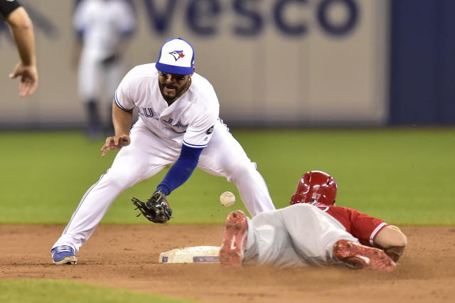 Toronto Blue Jays' Devon Travis loses the ball as Los Angeles Angels' Mike Trout steals second during the ninth inning of a baseball game in Toronto on Wednesday, May 23, 2018. (Frank Gunn/The Canadian Press via AP)
