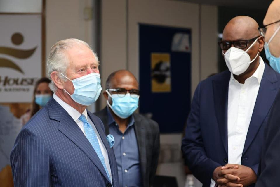 Prince Charles is given a tour of Jesus House church pastor Agu Irukwu to see an NHS vaccine pop-up clinic. (Ian Vogler – WPA Pool/Getty Images)