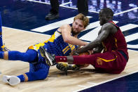 Indiana Pacers forward Domantas Sabonis (11) and Cleveland Cavaliers center Thon Maker (14) go to the floor for a loose ball during the second half of an NBA basketball game in Indianapolis, Thursday, Dec. 31, 2020. (AP Photo/Michael Conroy)