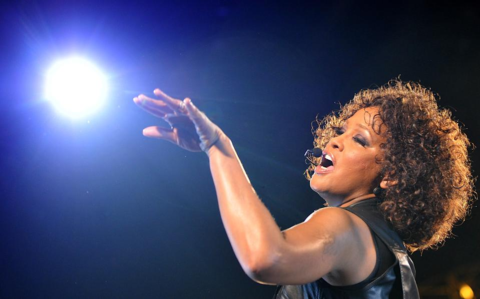"""US singer Whitney Houston performs on stage during her concert as part of her tour """"Nothing But Love"""" in Berlin on May 12, 2010. AFP PHOTO  DDP/ LENNART PREISS  GERMANY OUT (Photo credit should read LENNART PREISS/DDP/AFP via Getty Images)"""