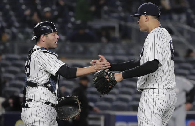 New York Yankees catcher Austin Romine (28) and pitcher Dellin Betances (68) shake hands after the Yankees beat the Miami Marlins 12-1 in a baseball game, Monday, April 16, 2018, in New York. (AP Photo/Julie Jacobson)