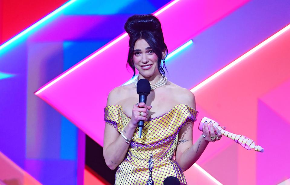 Dua Lipa is facing legal action amid allegations she profted from posting a paparazzi photo on her Instagram page. (Ian West/PA Images via Getty Images)