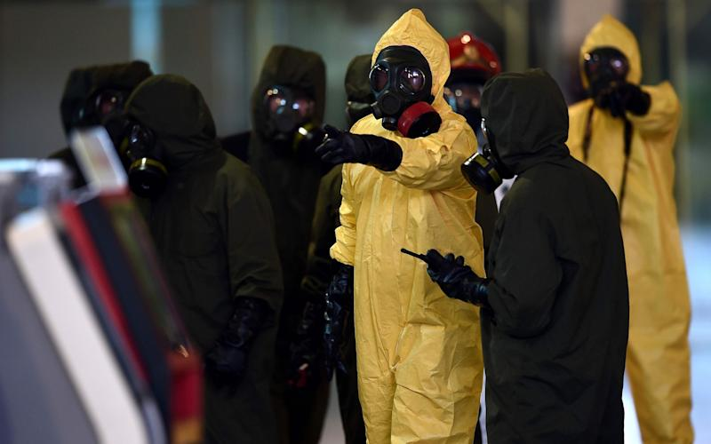 Members of Malaysia's Hazmat team conduct a decontamination operation at the departures terminal of the Kuala Lumpur International Airport 2 (KLIA 2) in Sepang on February 26, 2017 - Credit:  MANAN VATSYAYANA/AFP/Getty