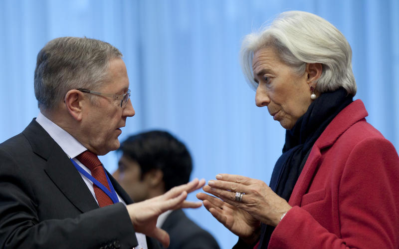 Managing Director of the International Monetary Fund Christine Lagarde, right, speaks with Chief Executive Officer of the European Financial Stability Facility Klaus Regling during a meeting of  eurogroup finance ministers in Brussels on Monday, March 4, 2013. The eurogroup finance ministers are set to discuss details of a bailout for cash-strapped Cyprus, further steps of assistance for Portugal and Ireland as well as the controversial issue of direct banking recapitalizations through Europe's permanent rescue fund. (AP Photo/Virginia Mayo)