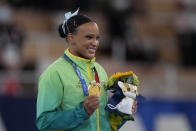 Rebeca Andrade of Brazil, poses after winning the gold medal in vault during the artistic gymnastics women's apparatus final at the 2020 Summer Olympics, Sunday, Aug. 1, 2021, in Tokyo, Japan. (AP Photo/Ashley Landis)