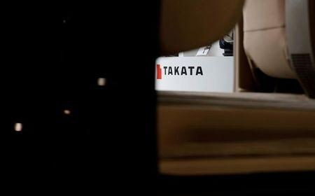 The logo of Takata Corp is seen on its display through a vehicle at a showroom for vehicles in Tokyo, Japan, May 11, 2016. REUTERS/Toru Hanai/File Photo
