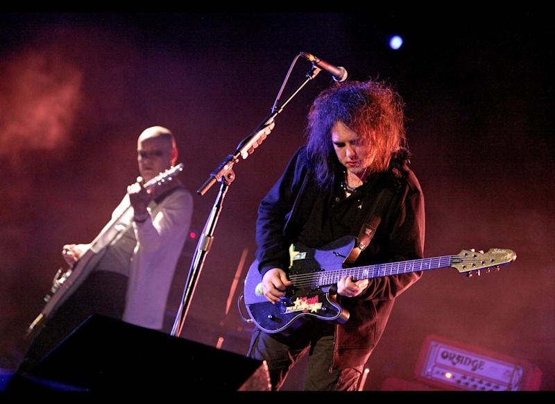 INDIO, CA - APRIL 19: Musicians Porl Thompson (L) and Robert Smith of the band The Cure perform during day three of the Coachella Valley Music & Arts Festival 2009 held at the Empire Polo Club on April 19, 2009 in Indio, California. (Photo by Trixie Textor/Getty Images)