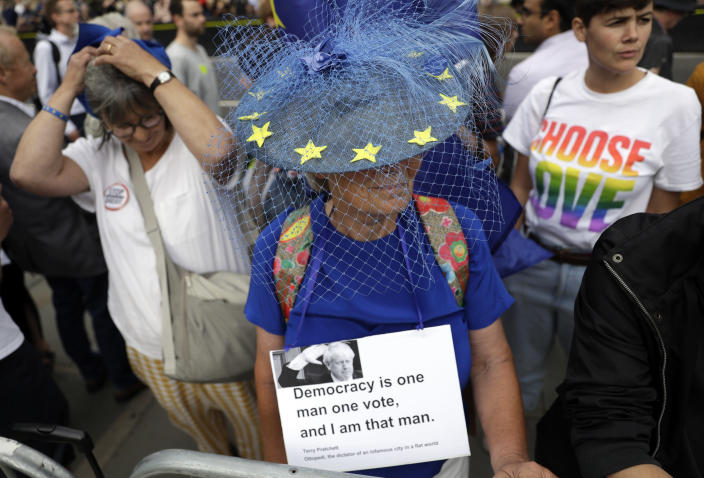 Anti-Brexit supporters take part in a protest at College Green near the Houses of Parliament in central London, Wednesday, Aug. 28, 2019. British Prime Minister Boris Johnson maneuvered Wednesday to give his political opponents even less time to block a no-deal Brexit before the Oct. 31 withdrawal deadline, winning Queen Elizabeth II's approval to suspend Parliament. (AP Photo/Matt Dunham)