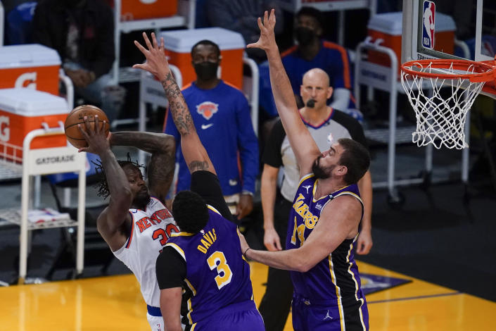 Los Angeles Lakers forward Anthony Davis (3) and center Marc Gasol (14) defend against New York Knicks forward Julius Randle (30) during the first quarter of a basketball game Tuesday, May 11, 2021, in Los Angeles. (AP Photo/Ashley Landis)
