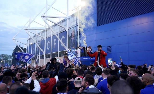 Leicester City fans celebrate victory in the FA Cup Final outside the King Power Stadium.