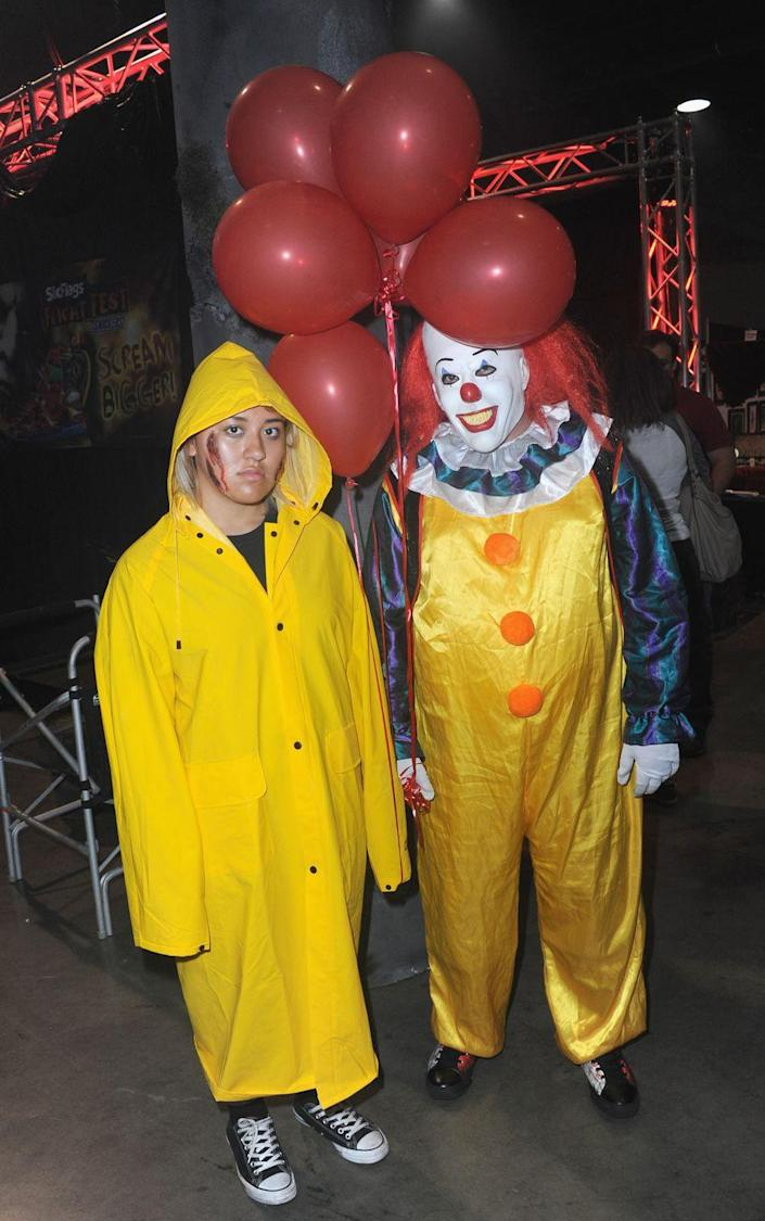 """<p>Give everyone nightmares for days by dressing up as Pennywise the clown and one of his many victims, Georgie. </p><p><a class=""""link rapid-noclick-resp"""" href=""""https://www.amazon.com/MCR-Safety-200CL-PVC-Coated-Raincoat/dp/B000RMIU7G?tag=syn-yahoo-20&ascsubtag=%5Bartid%7C10070.g.1923%5Bsrc%7Cyahoo-us"""" rel=""""nofollow noopener"""" target=""""_blank"""" data-ylk=""""slk:SHOP YELLOW RAINCOAT"""">SHOP YELLOW RAINCOAT</a></p><p><a class=""""link rapid-noclick-resp"""" href=""""https://www.amazon.com/Pennywise-Clown-Halloween-Horror-Cosplay-Costume/dp/B07VJJWWDB?tag=syn-yahoo-20&ascsubtag=%5Bartid%7C10070.g.1923%5Bsrc%7Cyahoo-us"""" rel=""""nofollow noopener"""" target=""""_blank"""" data-ylk=""""slk:SHOP PENNYWISE MASK"""">SHOP PENNYWISE MASK</a></p>"""