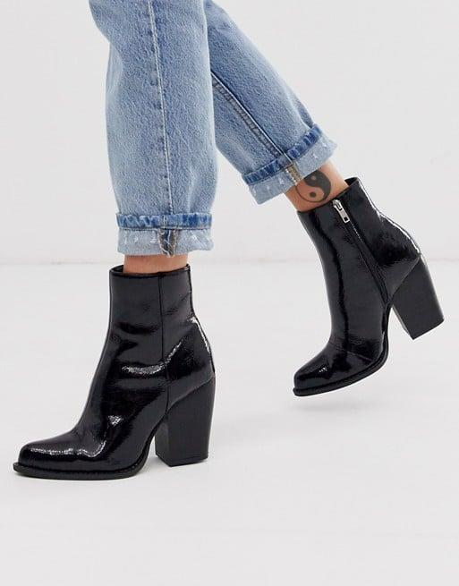 """<p>We love the patent leather finish on these <a href=""""https://www.popsugar.com/buy/ASOS-DESIGN-Robin-Heeled-Ankle-Boots-482902?p_name=ASOS%20DESIGN%20Robin%20Heeled%20Ankle%20Boots&retailer=us.asos.com&pid=482902&price=60&evar1=fab%3Aus&evar9=45235540&evar98=https%3A%2F%2Fwww.popsugar.com%2Ffashion%2Fphoto-gallery%2F45235540%2Fimage%2F46525728%2FASOS-DESIGN-Robin-Heeled-Ankle-Boots&list1=shopping%2Cfall%20fashion%2Cshoes%2Cboots%2Cfall&prop13=mobile&pdata=1"""" rel=""""nofollow"""" data-shoppable-link=""""1"""" target=""""_blank"""" class=""""ga-track"""" data-ga-category=""""Related"""" data-ga-label=""""https://us.asos.com/asos-design/asos-design-robin-heeled-ankle-boots-in-black-patent/prd/12229550?clr=black-patent&amp;colourWayId=16436580&amp;SearchQuery=&amp;cid=6455"""" data-ga-action=""""In-Line Links"""">ASOS DESIGN Robin Heeled Ankle Boots </a> ($60).</p>"""