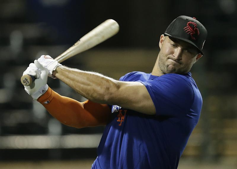 Tim Tebow warming up for the Scottsdale Scorpions. (AP)