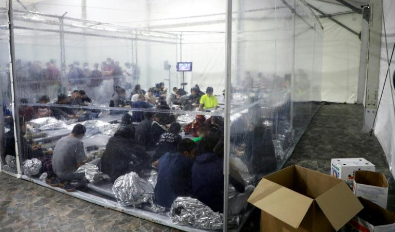 Migrants crowd a temporary processing center in Donna, Texas