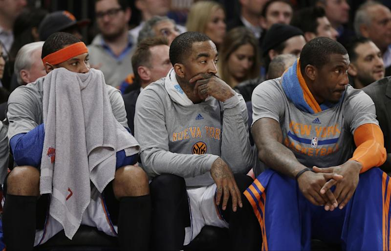 New York Knicks' Carmelo Anthony, left, J.R. Smith, center, and Amar'e Stoudemire, right, watch their team play during the first half of an NBA basketball game against the Philadelphia 76ers Monday, March 10, 2014, in New York. (AP Photo/Frank Franklin II)
