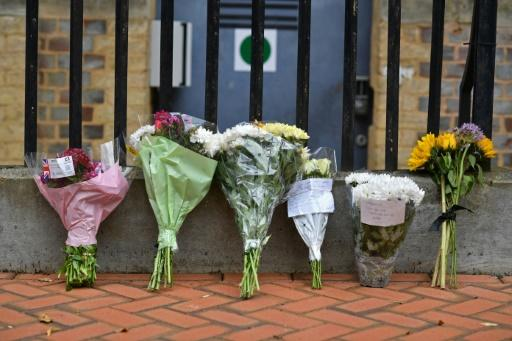 Well-wishers have left floral tributes outside a local police station in tribute to the victims of the attack