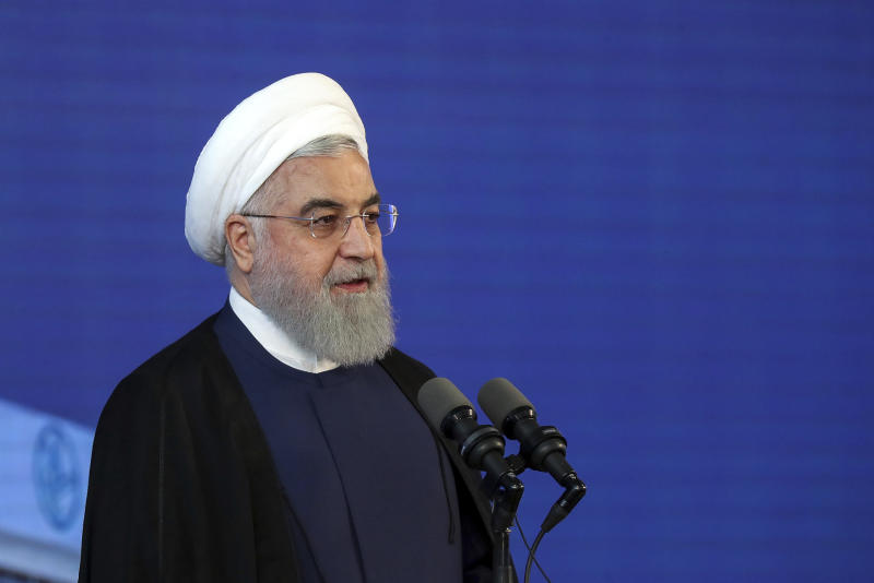 In this photo released by an official website of the office of the Iranian Presidency, Iranian President Hassan Rouhani speaks in a ceremony at Imam Khomeini International Airport some 25 miles (40 kilometers) south of the capital Tehran, Iran, Tuesday, June 18, 2019. President Rouhani says his country is not seeking to wage war against any nation while at the same time stressing that it will withstand mounting U.S. pressure and emerge victorious. (Iranian Presidency Office via AP)