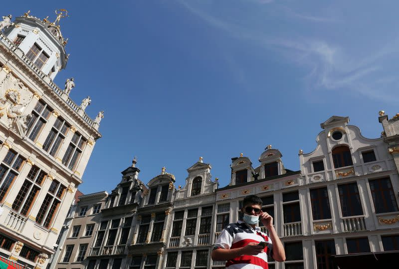 FILE PHOTO: A man wearing a protective mask, that became mandatory in Brussels' public places, walks at the Grand Place, amid the coronavirus disease (COVID-19) outbreak, in Brussels,