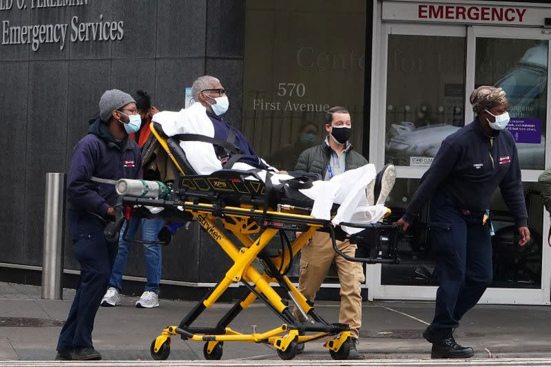 A man is wheeled out of a hospital on a stretcher in New York