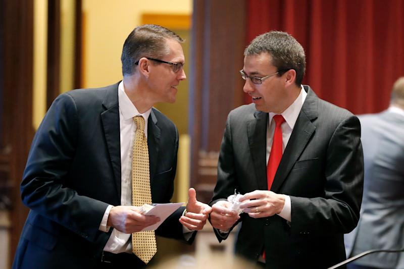 Sen. Randy Feenstra, left, talks with state Sen. Roby Smith in the Iowa Legislature in 2019. Feenstra will face Democrat J.D. Scholten in November for Congress. (Photo: Charlie Neibergall/ASSOCIATED PRESS)