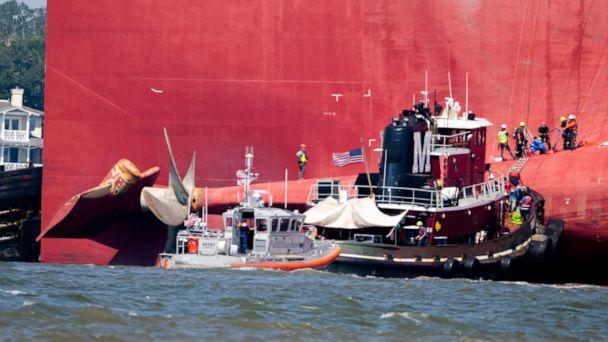 PHOTO: Rescuers work near the stern of the vessel Golden Ray as it lays on its side near the Moran tug boat Dorothy Moran, Monday, Sept. 9, 2019, in Jekyll Island, Ga. (Stephen B. Morton/AP)