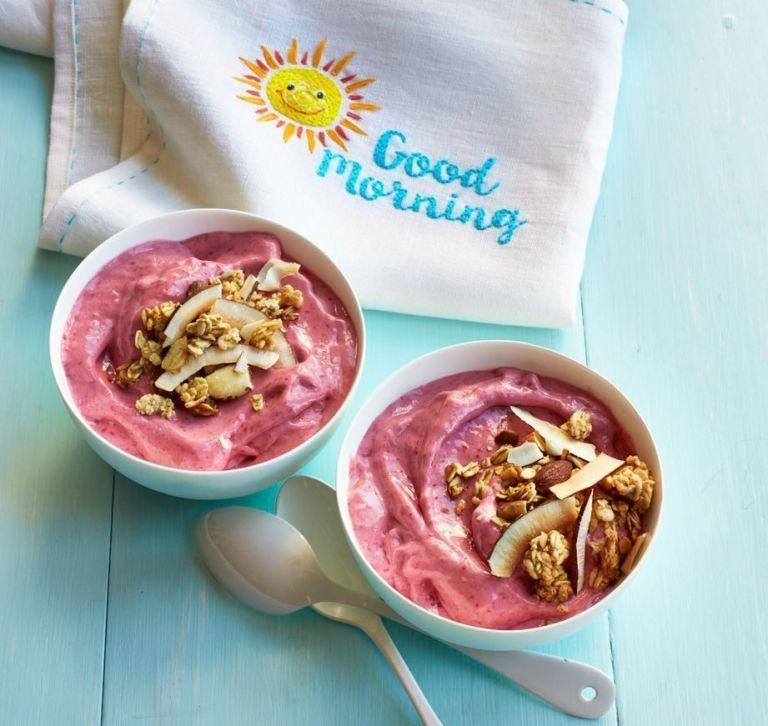 """<p>Start the day on a fresh note with this recipe that's loaded with raspberries, bananas, and crunchy granola. </p><p><em><strong><a href=""""https://www.womansday.com/food-recipes/food-drinks/recipes/a53598/smoothie-bowls/"""" rel=""""nofollow noopener"""" target=""""_blank"""" data-ylk=""""slk:Get the Smoothie Bowl recipe."""" class=""""link rapid-noclick-resp"""">Get the Smoothie Bowl recipe. </a></strong></em></p>"""
