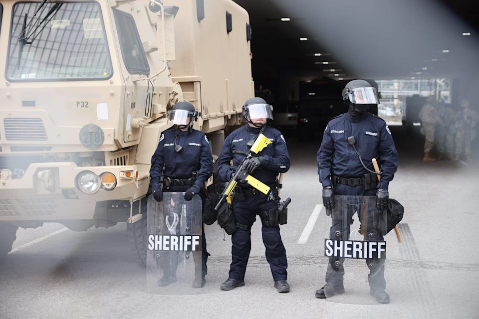 Police stand guard outside the Hennepin County Government Center as people await the verdict in the Derek Chauvin trial on April 20, 2021 In Minneapolis.