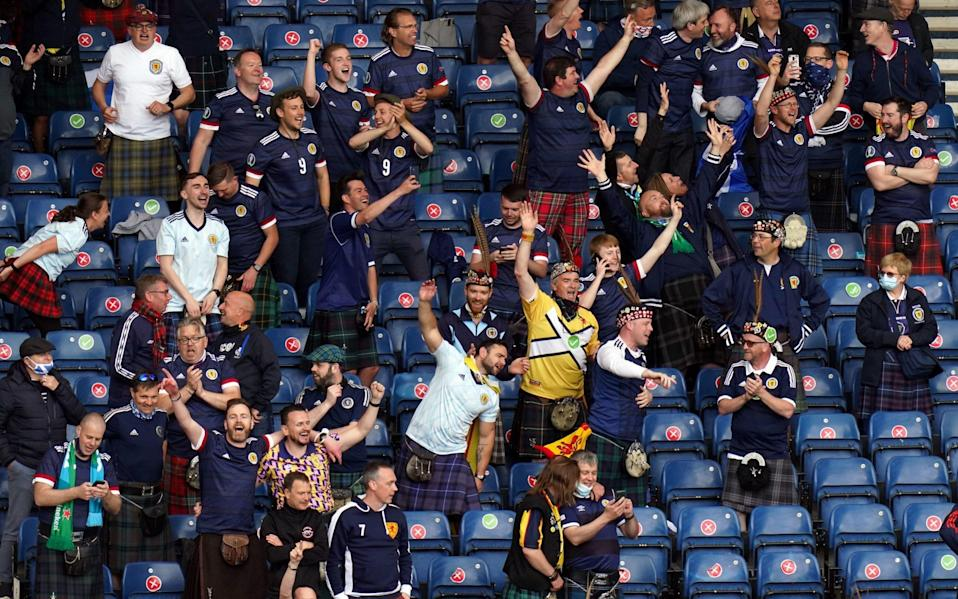 Scotland fans in the stands during the UEFA Euro 2020 Group D match at Hampden Park - Jane Barlow/PA