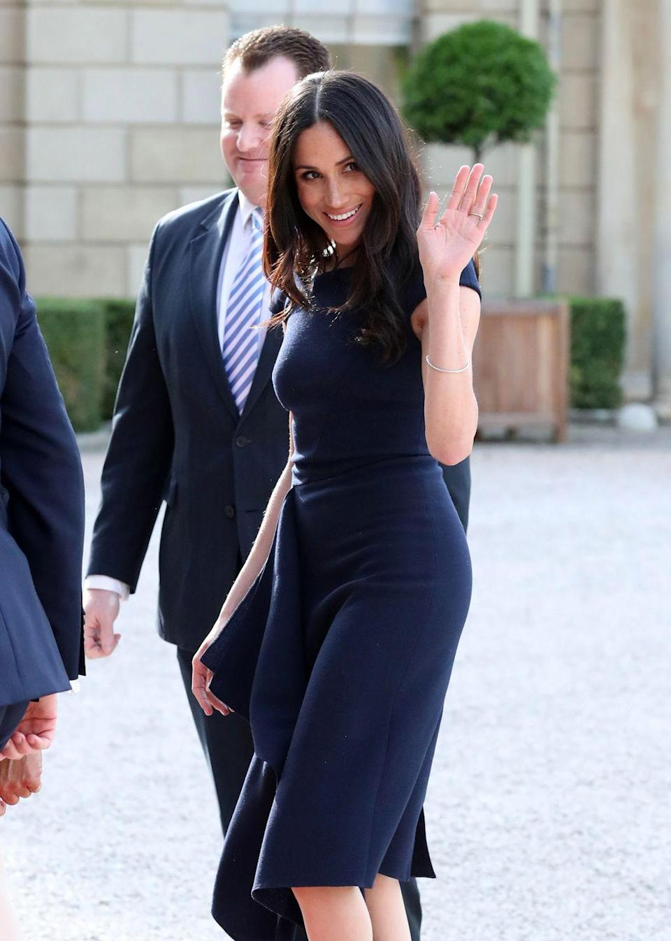 """<p>As for Meghan, the <a href=""""https://www.cosmopolitan.com/entertainment/a20746787/meghan-markle-doria-ragland-royal-wedding-rehearsal/"""" rel=""""nofollow noopener"""" target=""""_blank"""" data-ylk=""""slk:night before her wedding"""" class=""""link rapid-noclick-resp"""">night before her wedding</a> she opted for a similar navy dress. Classic.</p>"""