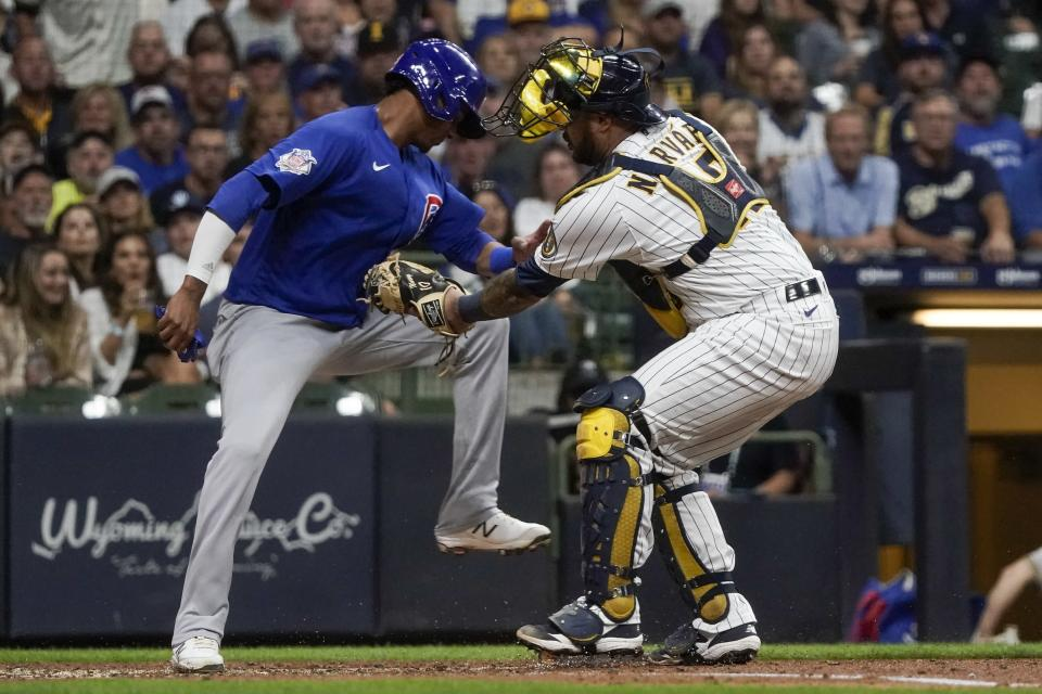 Milwaukee Brewers catcher Omar Narvaez tags out Chicago Cubs' Sergio Alcantara at home during the fourth inning of a baseball game Friday, Sept. 17, 2021, in Milwaukee. Alcantara tried to score from third on a ball hit by Zach Davies. (AP Photo/Morry Gash)