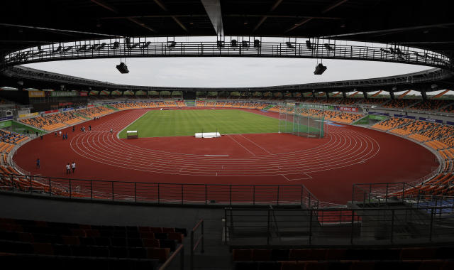 Visitors walk inside the newly built Athletics Stadium as they prepare for the 30th South East Asian Games at the New Clark City, Tarlac province, northern Philippines on Thursday Nov. 21, 2019. The country is hosting the SEA Games from Nov. 30-Dec. 12. (AP Photo/Aaron Favila)