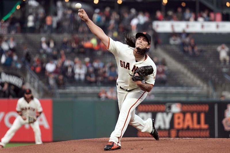 Aug 29, 2018; San Francisco, CA, USA; San Francisco Giants starting pitcher Dereck Rodriguez (57) pitches against the Arizona Diamondbacks during the first inning at AT&T Park.