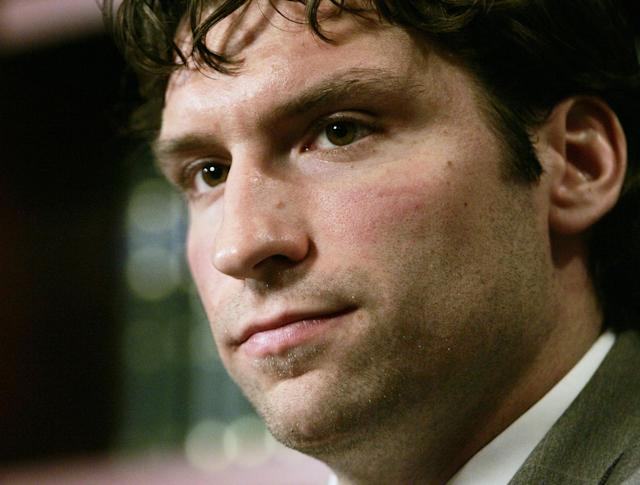 FILE - In this Dec. 23, 2004, file photo, NHL player Steve Moore listens to a question during a news conference in Toronto. A settlement has been reached in Moore's lawsuit against Todd Bertuzzi for his career-ending hit during an NHL game 10 years ago. (AP Photo/The Canadian Press, Adrian Wyld)