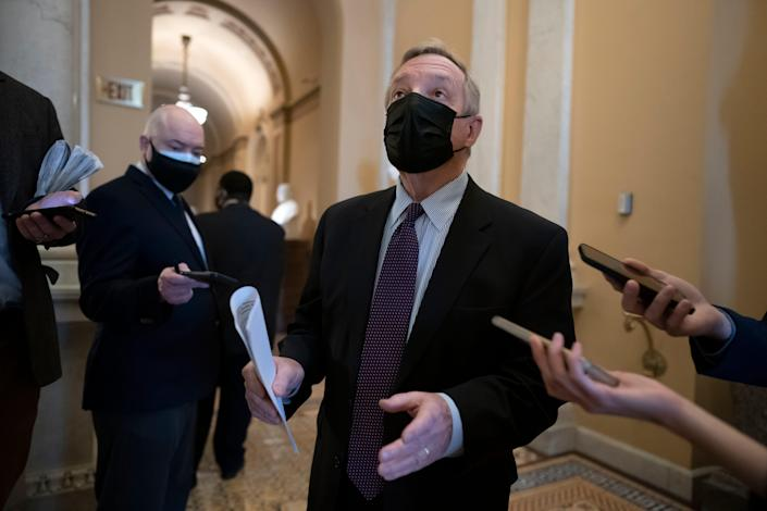 Sen. Dick Durbin, D-Ill., the majority whip, pauses for reporters asking about the impeachment case against former President Donald Trump, at the Capitol in Washington on Jan. 26, 2021.