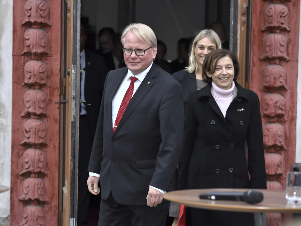 Sweden's Defence Minister Peter Hultqvist, left, and France's Defence Minister Florence Parly arrive for a press briefing at Karlberg Castle in Stockholm, Sweden, Friday Sept. 24, 2021, after a European Intervention Initiative meeting with ministers or delegations leaders from Belgium, Denmark, Estonia, Finland, Germany, the Netherlands, Norway, Portugal, Spain, the United Kingdom and Italy. (Claudio Bresciani/TT via AP)