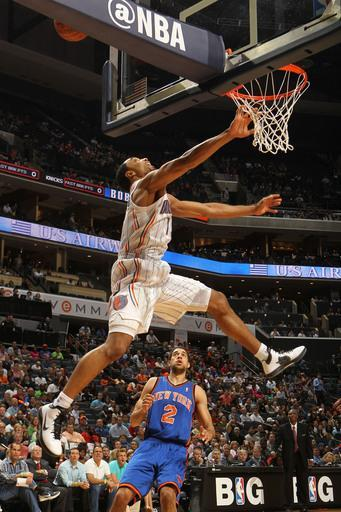 CHARLOTTE, NC - APRIL 26: Gerald Henderson #15 of the Charlotte Bobcats tries for the dunk against Landry Fields #2 and the New York Knicks at the Time Warner Cable Arena on April 26, 2012 in Charlotte, North Carolina. (Photo by Kent Smith/NBAE via Getty Images)