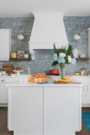 "<p>A backsplash, featuring watery blue tiles, plays up the beach vibe in designer <a href=""https://www.goodhousekeeping.com/home/decorating-ideas/a33978990/erika-ward-kitchen-organization/"" rel=""nofollow noopener"" target=""_blank"" data-ylk=""slk:Erika Ward's kitchen"" class=""link rapid-noclick-resp"">Erika Ward's kitchen</a>.</p>"