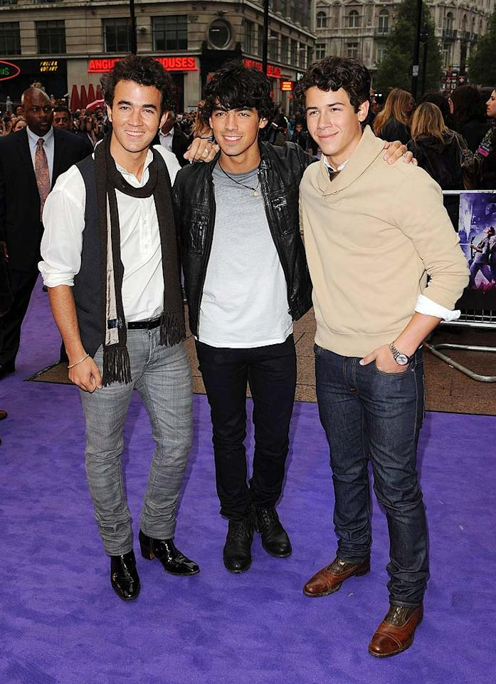"""The Jonas Brothers were also in the U.K. last week. Kevin, Joe, and Nick greeted hundreds of screaming fans at the London premiere of their 3D movie on Wednesday. The brothers had to cancel their weekend concert in Mexico due to concerns over swine flu. Eamonn McCormack/<a href=""""http://www.wireimage.com"""" target=""""new"""">WireImage.com</a> - May 13, 2009"""