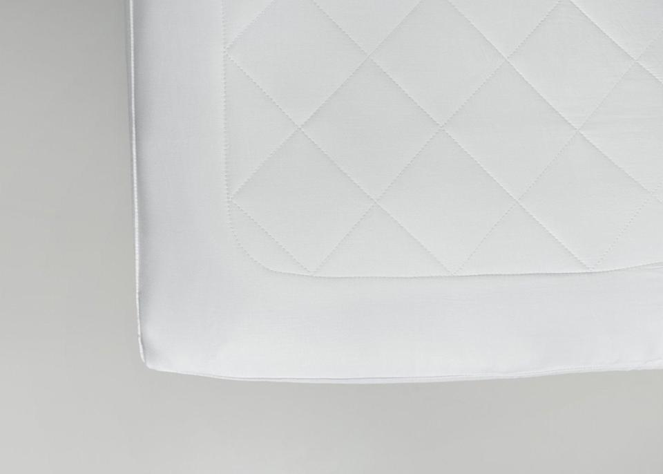 """<h2>Cozy Earth Bamboo Mattress Pad</h2><br>This bamboo mattress pad is temperature-regulating so you won't overheat or shiver while you slumber. It's soft and lightweight with a thinner profile for layering atop your go-to mattress and beneath your favorite sheets. <br><br><strong>Eco-Sleepers Say:</strong> """"Noticeably cooler. The mattress seems more comfortable! I would definitely recommend it to a friend."""" — <em>Billy W., Cozy Earth reviewer</em><br><br><em>Shop <strong><a href=""""https://cozyearth.com/collections/bedding"""" rel=""""nofollow noopener"""" target=""""_blank"""" data-ylk=""""slk:Cozy Earth"""" class=""""link rapid-noclick-resp"""">Cozy Earth</a></strong> </em><br><br><strong>Cozy Earth</strong> Bamboo Mattress Pad, $, available at <a href=""""https://go.skimresources.com/?id=30283X879131&url=https%3A%2F%2Fcozyearth.com%2Fproducts%2Fbamboo-mattress-pad%3Fvariant%3D52962550227"""" rel=""""nofollow noopener"""" target=""""_blank"""" data-ylk=""""slk:Cozy Earth"""" class=""""link rapid-noclick-resp"""">Cozy Earth</a>"""