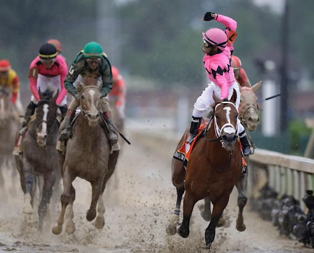 Luis Saez rides Maximum Security to the finish line during the 145th running of the Kentucky Derby. (AP)