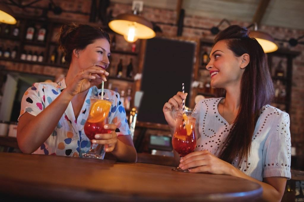 """Need an easy way to make friends as an adult? Try joining a <a href=""""https://bestlifeonline.com/trivial-pursuit-questions/?utm_source=yahoo-news&utm_medium=feed&utm_campaign=yahoo-feed"""" target=""""_blank"""">trivia</a> team at your favorite bar. """"Joining a local trivia team is a great idea because often these groups are made up of people who are laughing and having fun. <a href=""""https://bestlifeonline.com/funniest-facts/?utm_source=yahoo-news&utm_medium=feed&utm_campaign=yahoo-feed"""" target=""""_blank"""">Adding humor to your life</a> is good for your soul!"""" says Kulaga.  Additionally, the life coach notes that """"trivia teams are often scheduled in advance and on a specific day of the week. This helps you to better plan when socials are on a consistent day."""""""