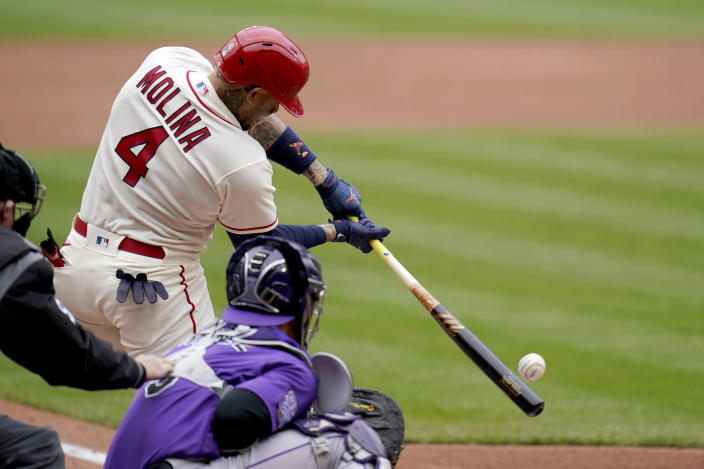 St. Louis Cardinals' Yadier Molina (4) hits a two-run single during the third inning of a baseball game against the Colorado Rockies Saturday, May 8, 2021, in St. Louis. (AP Photo/Jeff Roberson)